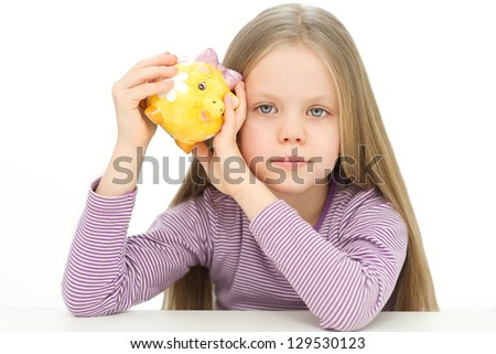 Picture of lovely small girl with piggy bank - stock photo