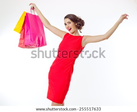 picture of lovely woman with shopping bags - stock photo