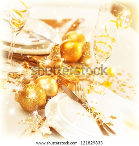 Picture of luxury festive table setting, beautiful white utensil decorated with golden balls and candles, elegant plate served with cutlery, Christmas home interior, New Year dinner - stock photo