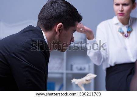 Picture of male mobbing victim and powerful businesswoman - stock photo