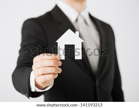 picture of man hand holding paper house - stock photo