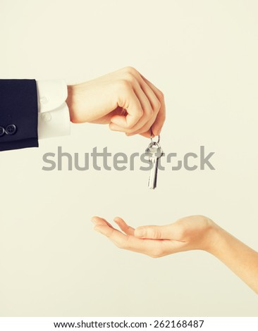 picture of man hand passing house keys to woman - stock photo