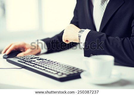 picture of man hands typing on keyboard and watching time - stock photo