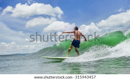 Picture of Man Surfing a Wave  - stock photo