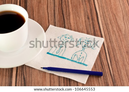 Picture of men and women on a napkin and cup of coffee - stock photo