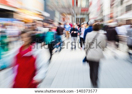 picture of moving crowd in the pedestrian area of the city with zoom effect - stock photo
