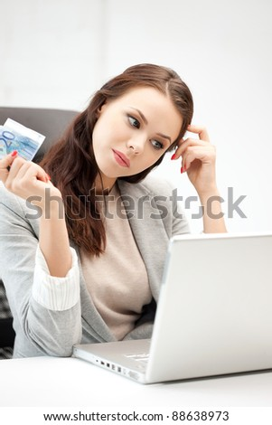 picture of pensive woman with laptop computer and euro cash money - stock photo