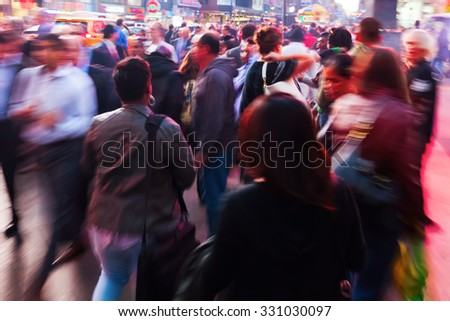 picture of people on the move in New York City at evening with intentional zoom and motion blur effect made by camera - stock photo