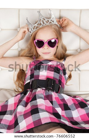 Picture of pretty young girl with pink glasses and princess crown - stock photo