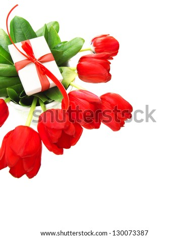 Picture of red tulips flowers and small white gift box on fresh green leaves, romantic still life for happy mothers day isolated on white background, festive border, birthday holiday, cute surprise - stock photo