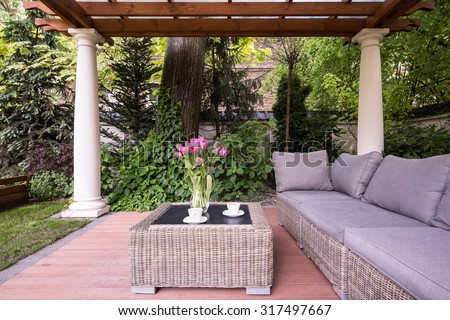 Picture of relaxation space in garden with elegant rattan furniture - stock photo