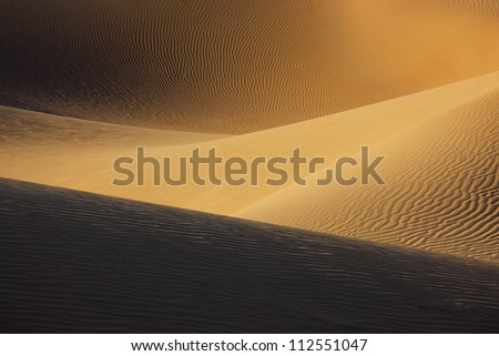 Picture of sand dunes in the Sahara desert of Morocco. - stock photo