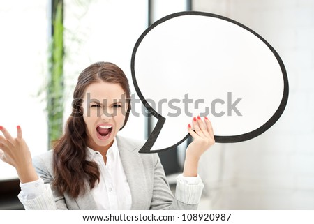picture of screaming businesswoman with blank text bubble - stock photo