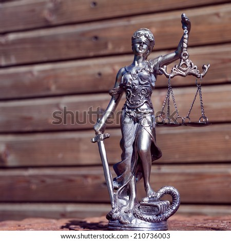 picture of sculpture of themis, femida or justice goddess on wood lining copy space background - stock photo