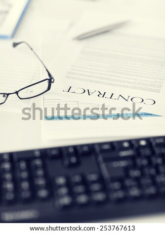 picture of signed contract paper with glasses - stock photo