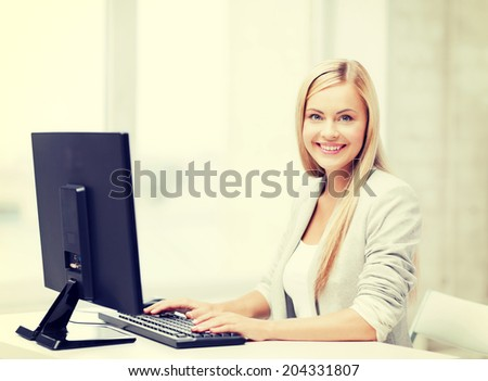 picture of smiling businesswoman using her computer - stock photo
