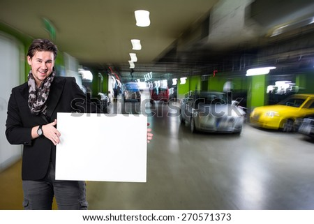 Picture of smiling handsome man with big blank board - stock photo