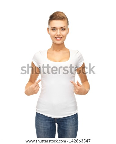 picture of smiling woman pointing at blank white t-shirt - stock photo