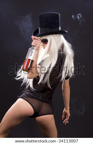 picture of smoking girl with bottle of whiskey - stock photo