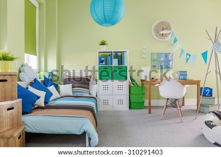 Picture of spacious kid room with sleeping and study area - stock photo
