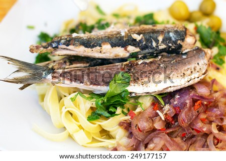 Picture of spaghetti olives and fish - stock photo