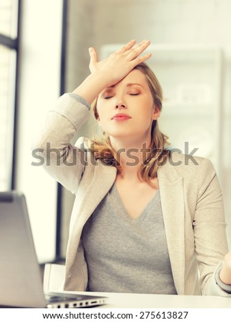 picture of stressed woman with laptop computer - stock photo