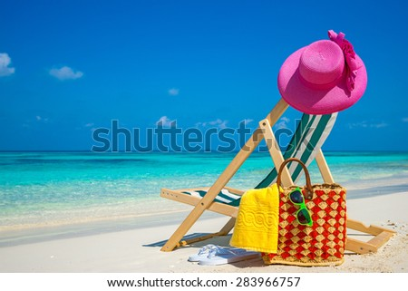 Picture of sunglasses on the tropical beach, vacation. Traveler dreams concept - stock photo