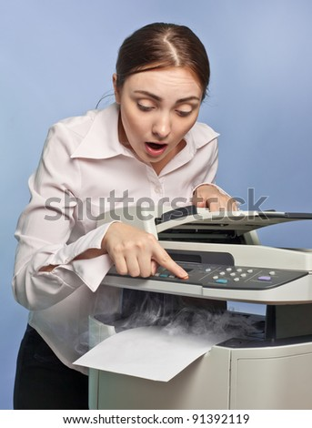 Picture of surprised businesswoman with smoking copier - stock photo