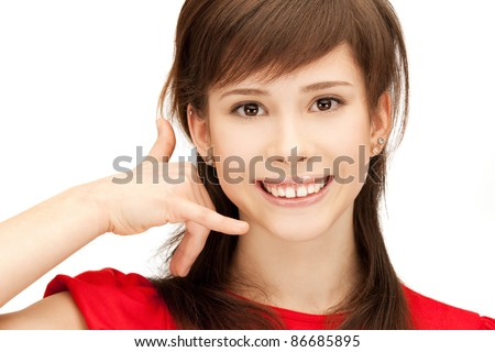 picture of teenage girl making a call me gesture - stock photo