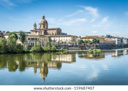Picture of the church San Frediano with river Arno in Florence - stock photo