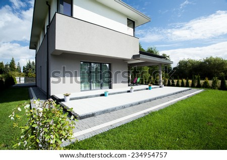 Picture of the great green yard of big luxury house - stock photo