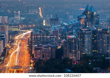 Picture of the night lighting of the city of Almaty, made from the top of the mountain. - stock photo