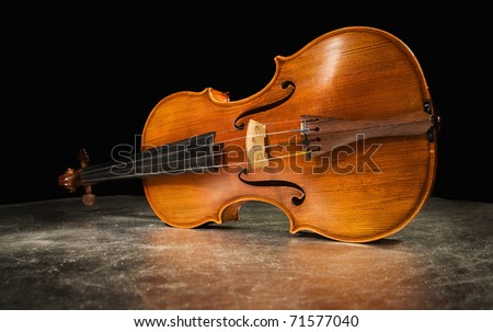 Picture of the old italian violin on a silver background - stock photo