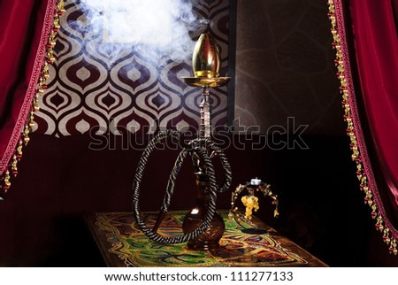 Picture of traditional eastern hookah on the table. - stock photo