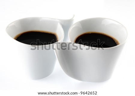 Picture of two cups of coffee on a white background - stock photo
