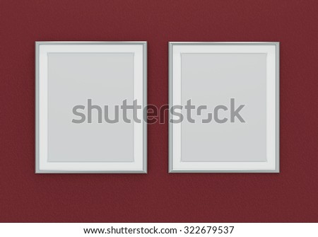 Picture of two silver picture frames over dark red wall - stock photo