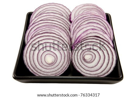 Picture of two sliced lines with onions on a black plate - stock photo