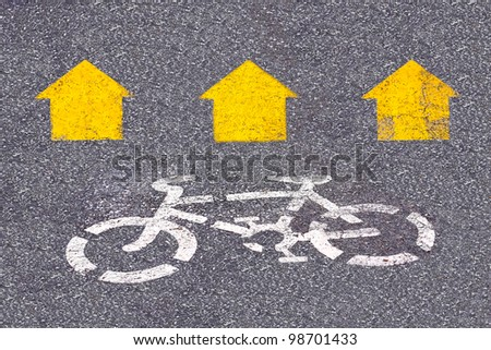 picture of white painted sign for bikes lane. - stock photo