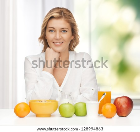 picture of woman in casual clothes with healthy breakfast - stock photo