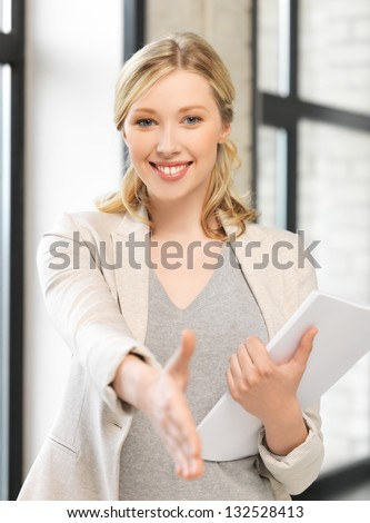 picture of woman with an open hand ready for handshake - stock photo