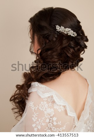 Picture of woman with beautiful hairstyle for wedding in lace dress - stock photo