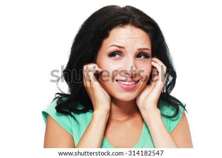 picture of woman with fingers in ears stop noise - stock photo