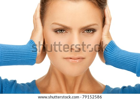 picture of woman with hands on ears - stock photo