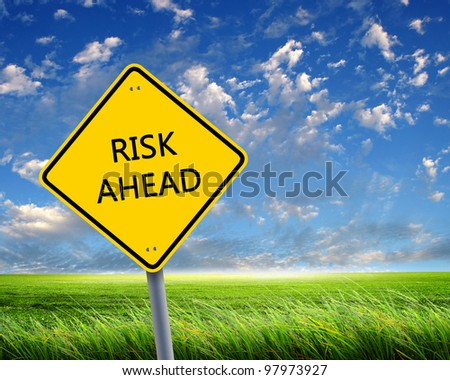 Picture of yellow road sign warning about risk ahead - stock photo