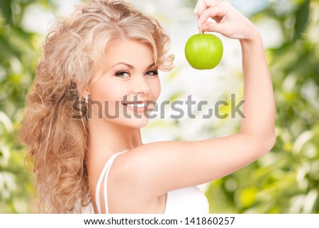 picture of young beautiful woman with green apple - stock photo