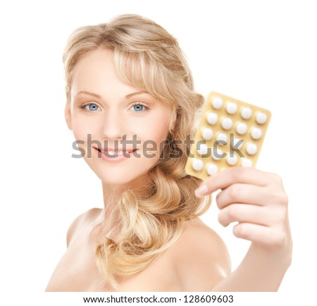 picture of young beautiful woman with pills . - stock photo
