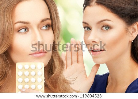 picture of young beautiful women with pills - stock photo