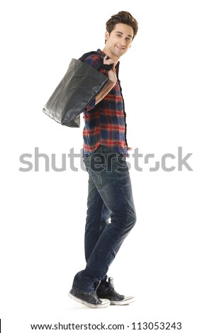 picture of young Casual man with bag walking posing - stock photo