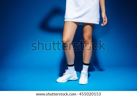 Picture of young tennis-player girl's legs in studio - stock photo