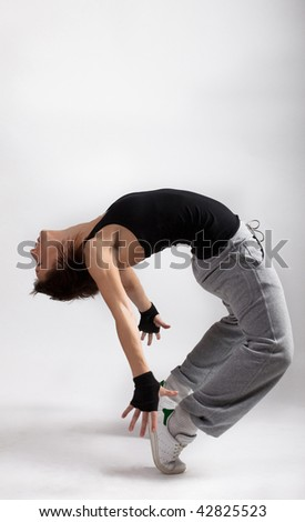Picture of young woman dancing break dance - stock photo